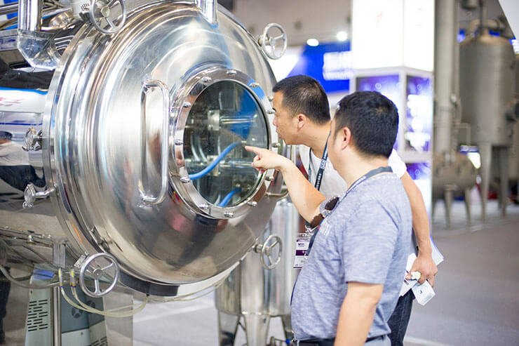 Minjie Attended CIPM in Wuhan with Vacuum Belt Dryer 03
